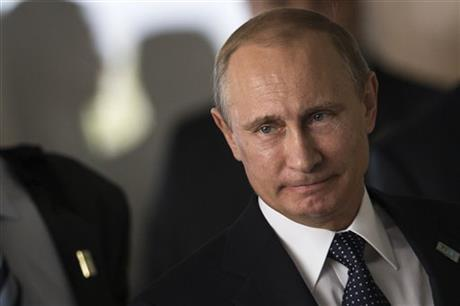 This, July 16, 2014, AP file photo shows Russia's President Vladimir Putin as he arrives for an official group photo during the BRICS summit at the Itamaraty palace, in Brasilia, Brazil. Months after Russia annexed Crimea and stepped up support for separatists in eastern Ukraine, Europe and the U.S. are still searching for an effective way to persuade Putin to change course.