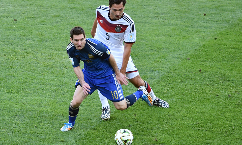 Germany's defender Mats Hummels (back) follows Argentina's forward and captain Lionel Messi during their 2014 FIFA World Cup final match at the Maracana Stadium in Rio de Janeiro on July 13, 2014. Photo: Getty Images