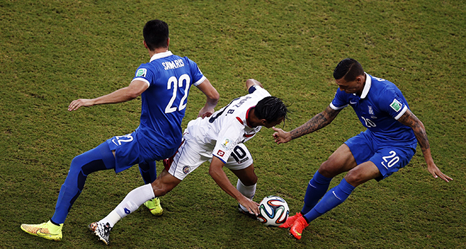Greece's midfielder Andreas Samaris (L) and defender Jose Holebas (R) challenge Costa Rica's forward Bryan Ruiz during the round of 16 football match between Costa Rica and Greece at Pernambuco Arena in Recife during the 2014 FIFA World Cup on June 29, 2014. Photo: Getty Images