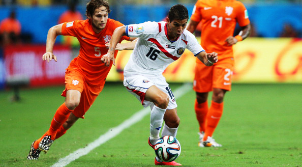 Cristian Gamboa of Costa Rica controls the all as Daley Blind of the Netherlands gives chase during their World Cup Quarter Final match at Arena Fonte Nova on July 5, 2014 in Salvador, Brazil. Photo: Getty Images