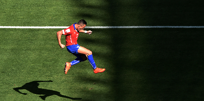 Chile's forward Alexis Sanchez celebrates after scoring a goal during the round of 16 football match between Brazil and Chile at The Mineirao Stadium in Belo Horizonte during the 2014 FIFA World Cup on June 28, 2014. Photo: Getty Images