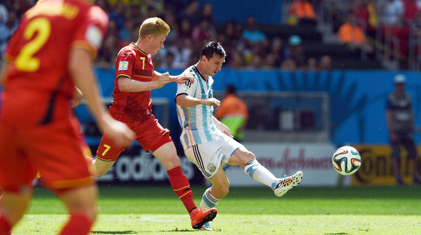 Belgium's midfielder Kevin De Bruyne (L) vies with Argentina's forward Lionel Messi (R) during their World Cup quarter-final match at the Mane Garrincha National Stadium in Brasilia on July 5, 2014. Photo: Getty Images