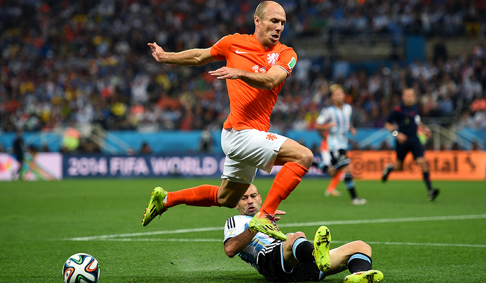 Arjen Robben of the Netherlands is tackled by Javier Mascherano of Argentina during the 2014 FIFA World Cup Brazil Semi Final match between Netherlands and Argentina at Arena de Sao Paulo on July 9, 2014 in Sao Paulo, Brazil. Photo Getty Images