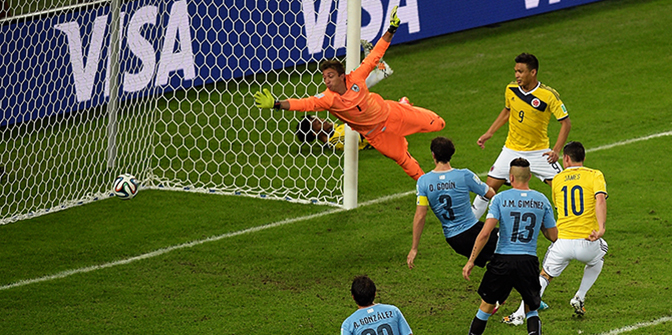 James Rodriguez of Colombia scores his team's second goal and his second of the game past goalkeeper Fernando Muslera of Uruguay during the 2014 FIFA World Cup Brazil round of 16 match between Colombia and Uruguay at Maracana on June 28, 2014 in Rio de Janeiro, Brazil. Photo: Getty Images