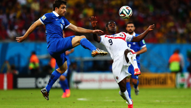 Sokratis Papastathopoulos of Greece challenges Joel Campbell of Costa Rica during their 2014 FIFA World Cup Round of 16 match at Arena Pernambuco on June 29, 2014 in Recife, Brazil. Photo: Getty Images