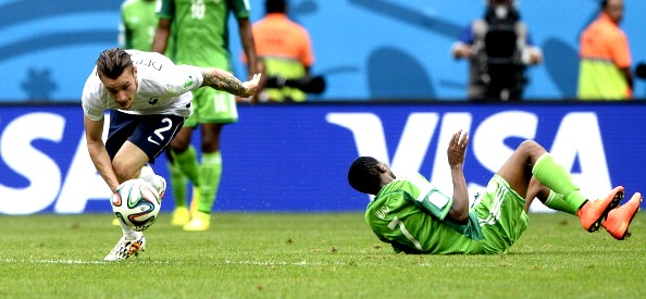 France's defender Mathieu Debuchy (L) advances with the ball after challenging Nigeria's forward Ahmed Musa during the round of 16 football match between France and Nigeria at the Mane Garrincha National Stadium in Brasilia during the 2014 FIFA World Cup on June 30, 2014. Photo: Getty Images