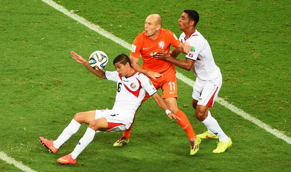 Arjen Robben of the Netherlands competes for the ball with Oscar Duarte (L) and Michael Umana of Costa Rica during their World Cup Quarter Final match at Arena Fonte Nova on July 5, 2014 in Salvador, Brazil. Photo: Getty Images