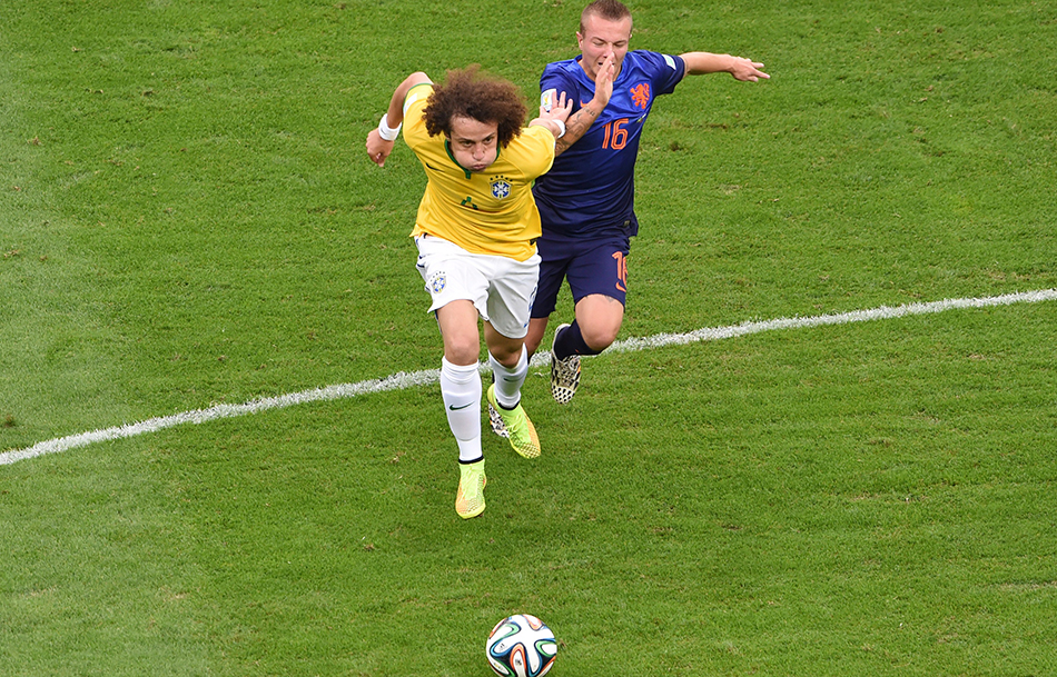 Brazil's defender David Luiz (L) and Netherlands' midfielder Jordy Clasie vie for the ball during the third place play-off football match between Brazil and Netherlands during the 2014 FIFA World Cup at the National Stadium in Brasilia on July 12, 2014. Photo: Getty Images