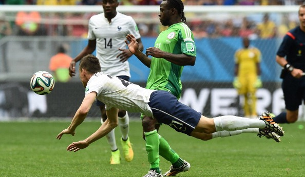 France's defender Laurent Koscielny (front) challenges Nigeria's forward Victor Moses during the round of 16 football match between France and Nigeria at the Mane Garrincha National Stadium in Brasilia during the 2014 FIFA World Cup on June 30, 2014. Photo: Getty Images