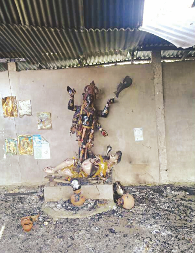 The charred idols of the temple. The photos were taken yesterday. Photo: Focus Bangla