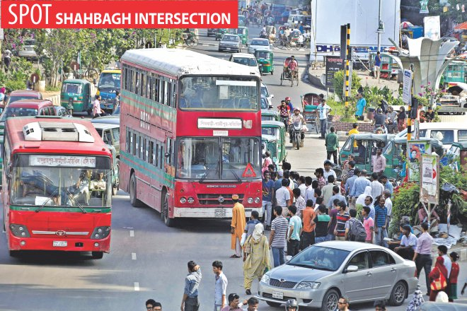 A double-decker stops in the middle of Shahbagh intersection to drop off and take on passengers halting the traffic flow behind.  Photo: Rashed Shumon