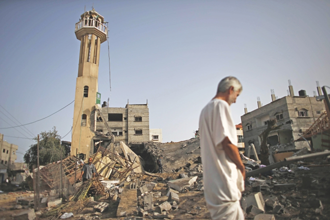 A Palestinian man inspects the rubble of a destroyed mosque following an Israeli military strike in the Nusseirat refugee camp in the central Gaza Strip. Photo:AFP