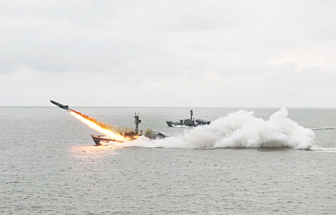 A ship fires missile during an annual exercise of Bangladesh Navy in the Bay of Bengal yesterday.  Photo: Anurup Kanti Das