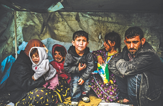 A Syrian refugee family from Aleppo stay under a shelter during a rainy day, in Istanbul, March 2014 Source: UNHCR