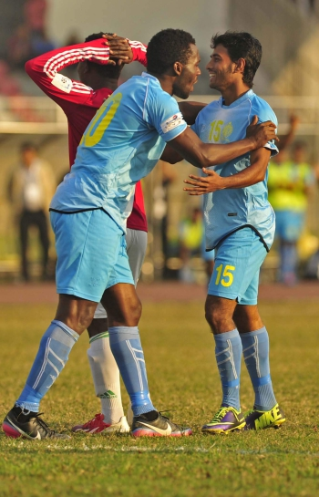 Jamal Hossain's (R) fourth-minute goal gave Abahani a 1-0 win against BJMC at the Bangabandhu National Stadium yesterday. PHOTO: STAR