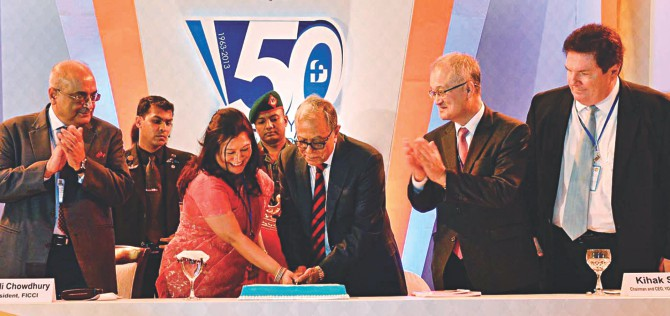 President Abdul Hamid and Foreign Investors' Chamber of Commerce and Industry President Rupali Chowdhury cut a cake to mark the association's 50th founding anniversary at Hotel Sonargaon in Dhaka yesterday. Photo: PID