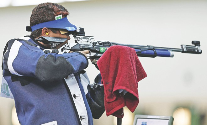 Bangladesh's Abdullah Hel Baki aims at the target during the men's 10m Air Rifle event of the 2014 Commonwealth Games at the Barry Buddon Shooting Centre in Glasgow, Scotland yesterday.  PHOTO: REUTERS