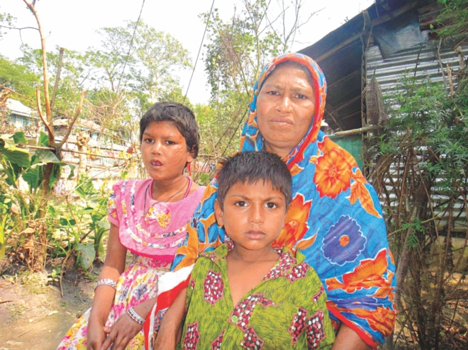 Aduri with her mother and brother at their Jainkathi village home in Patuakhali Sadar upazila. PHOTO: STAR