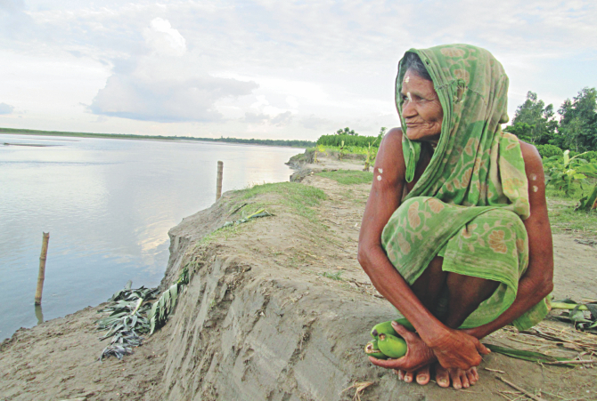 Mala Rani Barmoni, the 88 year old widow of Dharla river basin, has lost all her assets to river erosion. Photo: Star
