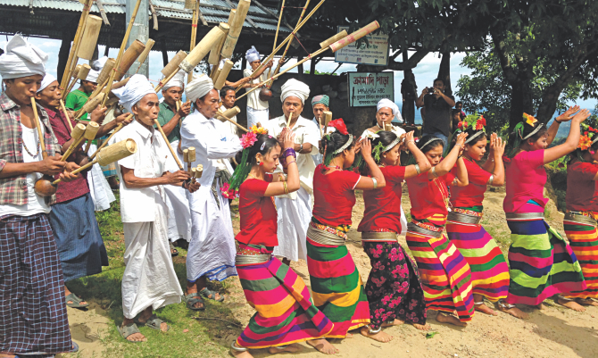 A cultural programme of Mro community at Cramadipara of Thanchi in Bandarban. Their culture and livelihood have increasingly come under threat with their farmland and ancestral homes being taken over. The photo was shot recently.    Photo: Pinaki Roy