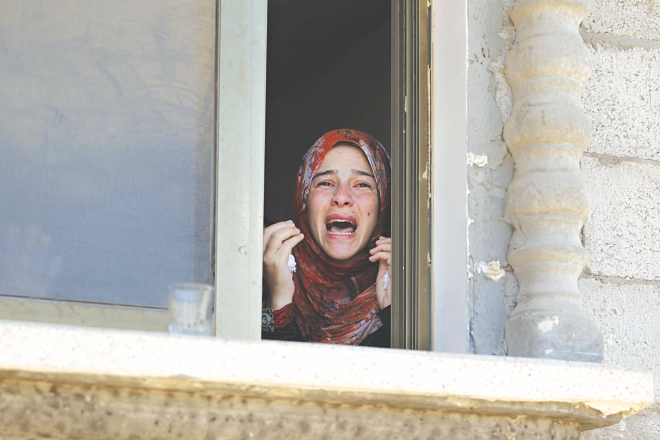 A Palestinian relative mourns during the funeral of four members of the Moamer family after they were killed in an Israeli air strike in southern Gaza Strip city of Rafah yesterday. Photo: AFP