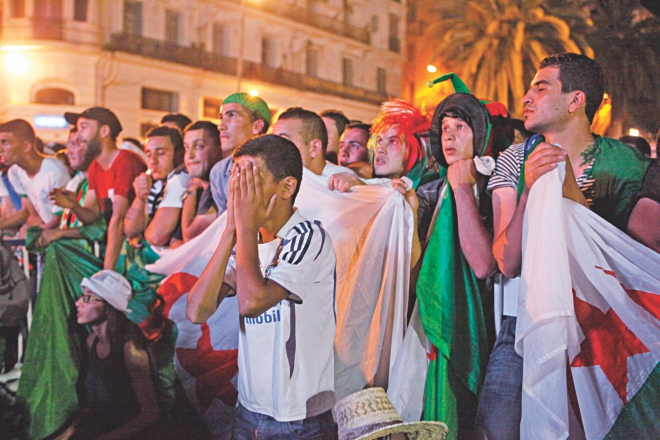 So close, yet so far ... Algerian fans can't take the pain of losing to Germany in extra-time after keeping their opponents at bay for regulation 90 minutes. PHOTO: GETTY IMAGES