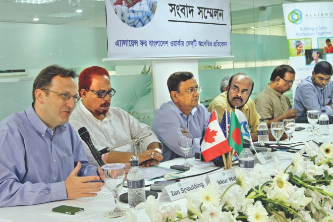 Left, Ian Spaulding, adviser to Alliance for Bangladesh Worker Safety, speaks at a press briefing in Dhaka yesterday. Third from left, Rabin Mesbah, managing director of the Alliance, was also present.  Photo: Star