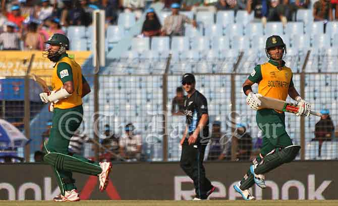 South African top scorers Hashim Amla and Jean-Paul Duminy run between the wicket in a World T20 match against New Zealand today in Chittagong. Photo: Anurup Kanti Das