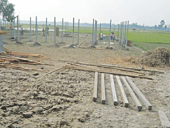 An Awami Leaguer is getting structures built on a piece of land that belongs to Bhabani Kanta Sen at Rasulpur of Patgram in Lalmonirhat. The Hindu family had to seek help of the police to ward off the aggression by the ruling party man. Photo: Star