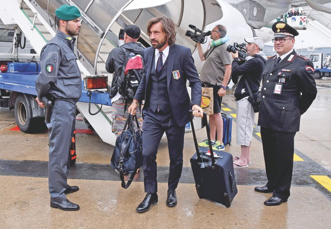 Back home ... Italy's Andrea Pirlo arrives at the Malpensa Airport in Milan on Thursday. PHOTO: GETTY
