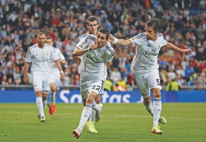 Real Madrid's Angel Di Maria (C) celebrates his goal against Almeria at the Santiago Bernabeu on Saturday. Photo: Reuters