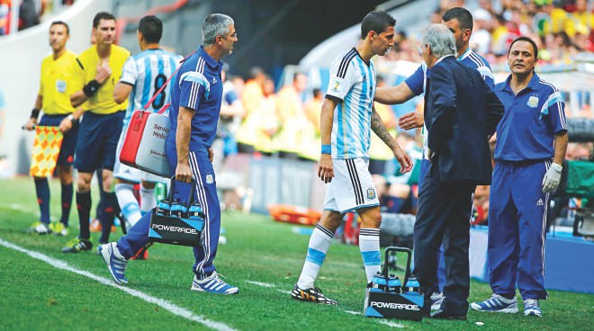 Argentina midfielder Angel Di Maria (C) leaves the field of play after picking up an injury during their World Cup quarterfinal against Belgium at Estadio Nacional in Brasilia on Saturday. PHOTO: REUTERS