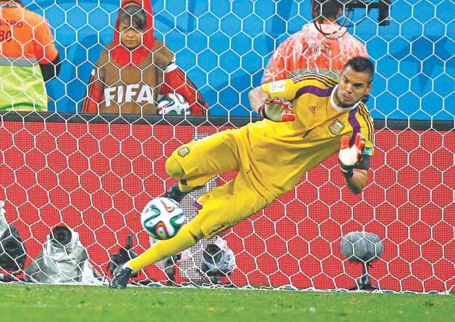 Argentina goalkeeper Sergio Romero made two saves in the shootout to take the Albiceleste to Sunday's World Cup final against Germany with a 4-2 tie-break win over the Netherlands in the second semifinal at The Corinthians Arena in Sao Paulo yesterday.   Photo: Reuters