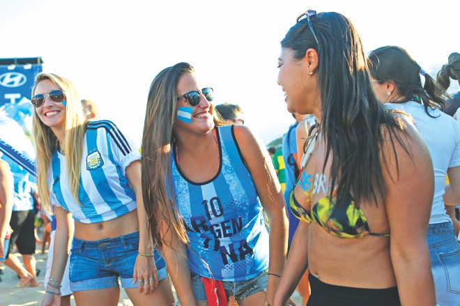 Argentina and Brazil fans gather at the FIFA Fan Fest at Maracana in Rio de Janeiro on Wednesday. PHOTO: GETTY