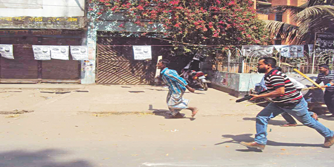 Armed Awami League cadres chase their party rivals on a road in Sreepur upazila of Gazipur on Saturday during a clash between the supporters of a party-backed chairman candidate in the upazila polls and Awami League rebel candidate there. Photo: Star