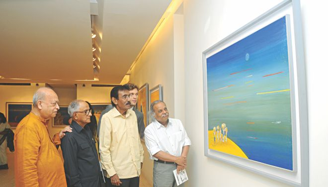 Guests and the artist at the exhibition.
