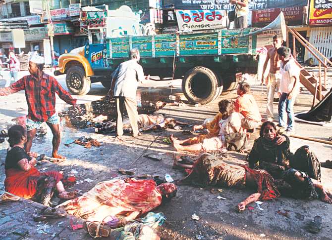 After the hail of grenades on an Awami League rally on Bangabandhu Avenue a few rush to help as the injured regain consciousness surrounded by bodies on this day 10 years ago. Photo: File
