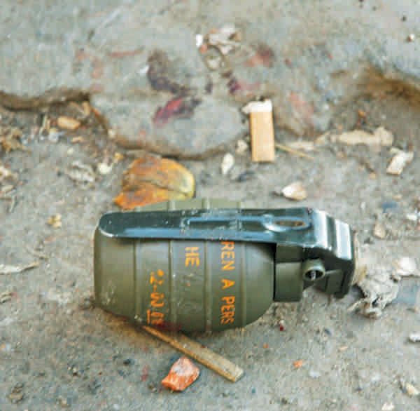 An unexploded grenade from the scene of the 21st August blast. Photo: shawkat jamil