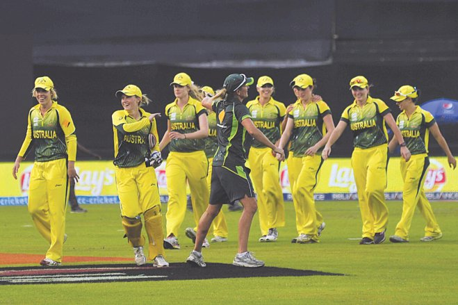 Australian women cricketers celebrate their close 8-run win against the West Indies in the ICC Women's World T20 first semifinal at Mirpur yesterday. Photo: Firoz Ahmed