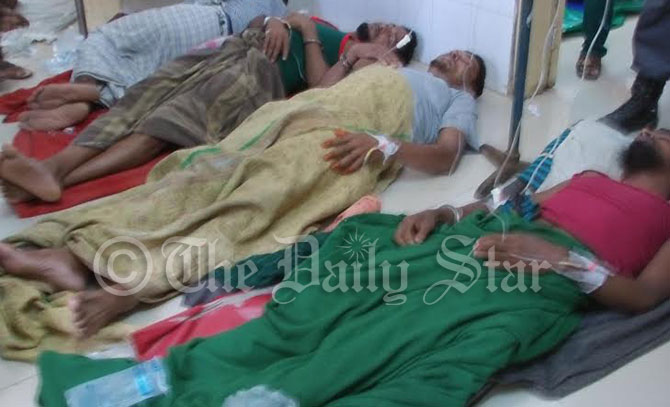 Inmates of Bagerhat district jail lie on floor of the Sadar hospital as they fell sick after having an improved diet on Pahela Baishakh yesterday. Photo: Star