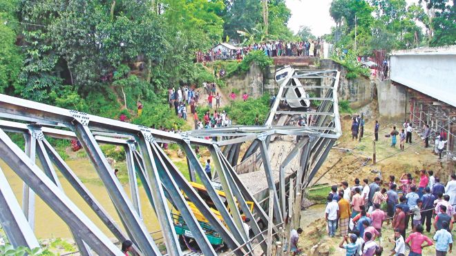 This bailey bridge in Manikchhari upazila of Khagrachhari collapsed yesterday when a stone-laden truck and a microbus got on it, injuring at least 15 people and severing road communications with Chittagong. Photo: Star