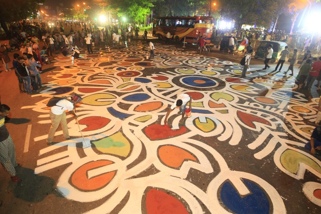 "Airtel and the daily Prothom Alo, in association with Berger Paints, organised ""Alpona-e Baishakh""-- a street painting, stretching across Manik Mia Avenue -- to celebrate Pahela Baishakh, for the third consecutive year. The programme began in the late hours of yesterday and went on deep into the night, leaving one of the main streets of the capital exploding into bright, joyful colours on the dawn of Pahela Baishakh. Photo: Star"