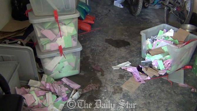 Police recover vandalised ballot boxes from a village after Jamaat-Shibir activists looted three ballot boxes and set fire to another one at Hazrakati Primary School polling centre in Monirampur of Jessore. Photo: Star
