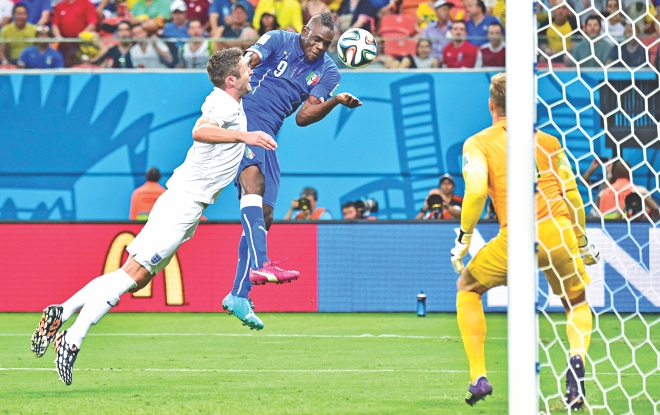 Italy striker Mario Balotelli is not all about muscle and brute power, he has got an intelligent head on his broad shoulders too. Here Super Mario heads in the winning goal against England at the Arena Amazonia on Saturday. Photo: AFP