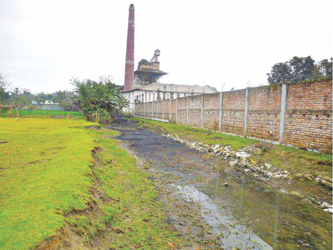 This apparent puddle is actually the Bamondanga river at Sakerpur area of Nilphamari town.  Photo: Star