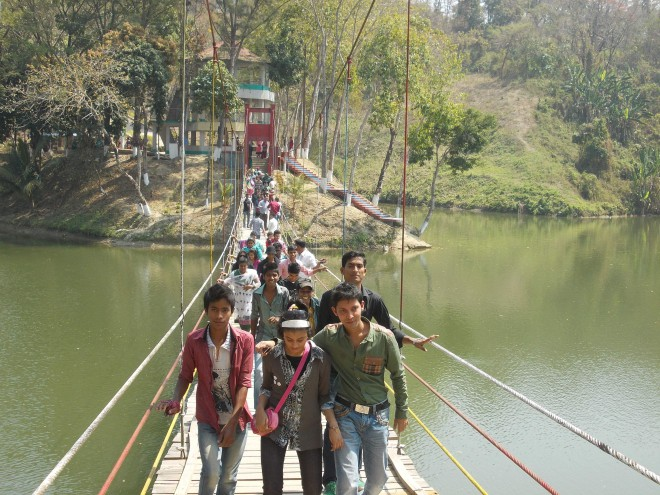 Meghla area of Bandarban sees lively presence of tourists as people seeking a temporary relief from the din and bustle of daily life have started thronging the picturesque hill district. PHOTO: STAR