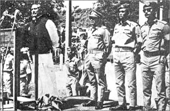 Bangabandhu Sheikh Mujibur Rahman speaks at the inauguration of Comilla Military Academy in 1973. Maj Gen Ziaur Rahman, then deputy chief of army staff, is standing, right, behind Bangabandhu. Photo: File