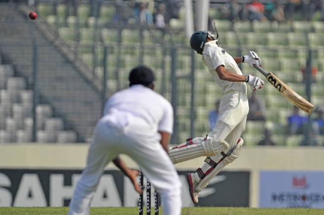 BOUNCED OUT! Bangladesh batsman Nasir Hossain desperately tries to avoid a bouncer. His athleticism however did count for nothing as the flamboyant batsman was given out caught behind on the opening day of the first Test against Sri Lanka at the Sher-e-Bangla National Stadium in Mirpur yesterday. The Lankans employed the short stuff well to bowl the home side out for a modest 232. Photo: Firoz Ahmed