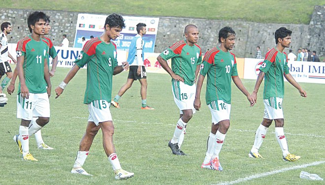 A devastated Bangladesh national footballers hang their heads in disappointment after their exit from the SAFF Championship in September in Nepal, losing their last game against Pakistan 2-1. Photo: Star File