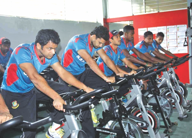 Bangladesh national players crunch in some valuable gym-time at the indoor facilities of Sher-e-Bangla National Stadium yesterday afternoon. National selectors are expected to announce the final squad for the West Indies series before Eid. PHOTO: STAR